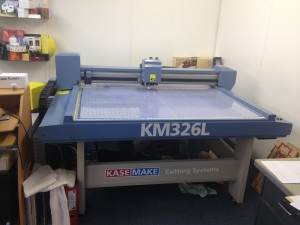 The machine used to cut out the sample box
