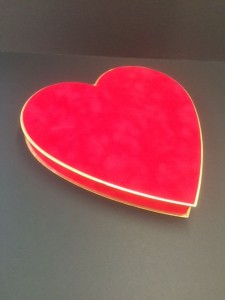 Heart shaped chocolate box covered in red suedel